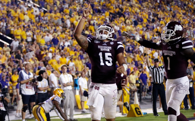 Mississippi State quarterback Dak Prescott (15) celebrates his 56 yard touchdown carry with wide receiver De'Runnya Wilson (1) in the second half of an NCAA college football game against Mississippi State in Baton Rouge, La., Saturday, Sept. 20, 2014. (AP Photo/Gerald Herbert)