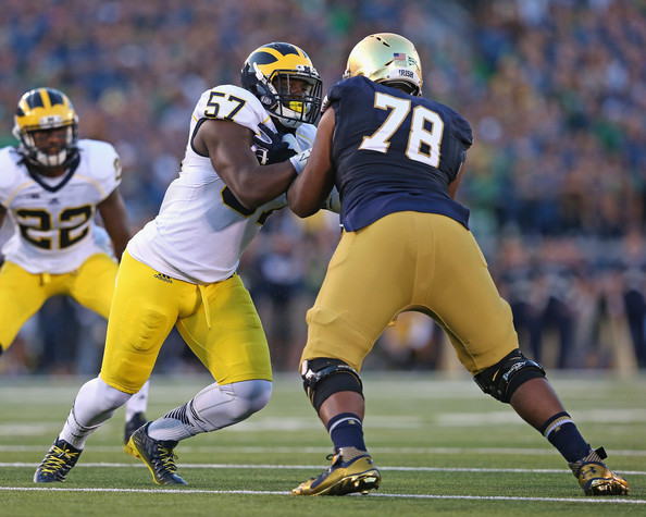 Ronnie Stanley blocking Michigan's Frank Clark by Jonathan Daniel/Getty Images