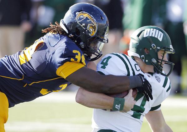 Kent State's Richard Gray sacks Ohio's Tyler Tettleton during the first quarter of an NCAA college football game, Friday, Nov. 23, 2012, in Kent, Ohio.  (AP Photo/Ron Schwane)