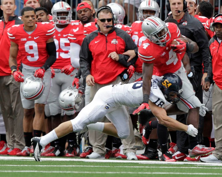Ohio State running back Curtis Samuel, right, is forced out of bounds by Kent State safety Nate Holley during the fourth quarter of an NCAA college football game Saturday, Sept. 13, 2014, in Columbus, Ohio. Ohio State beat Kent State 66-0. (AP Photo/Jay LaPrete)