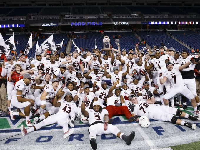 NIU celebrating 2014 MAC title (Rick Osentoski/USA TODAY Sports)