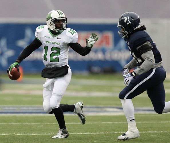 Rice LB Alex Lyons pursuing Marshall QB Rakeem Cato (Photo Courtesy of Bob Levey/Getty Images North America)