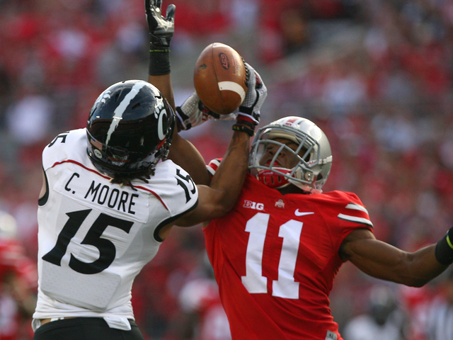 Cincinnati wide receiver Chris Moore catches a 60-yard touchdown pass with 13:36 remaining in the first quarter, Saturday, Sept, 27, 2014, at Ohio Stadium in Columbus. Moore finished with three receptions for 221 yards and three touchdowns. Kareem Elgazzar | WCPO