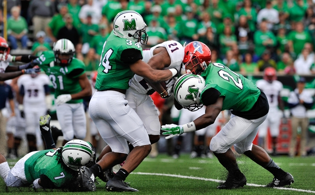 Oct 25, 2014; Huntington, WV, USA; Marshall Thundering Herd defensive back Rodney Allen (34) and linebacker D.J. Hunter (22) tackle Florida Atlantic Owls defensive back D'Joun Smith (21) on a kickoff return in the first quarter at Joan C. Edwards Stadium. Marshall defeated Florida Atlantic 35-16. Mandatory Credit: Michael Shroyer-USA TODAY Sports
