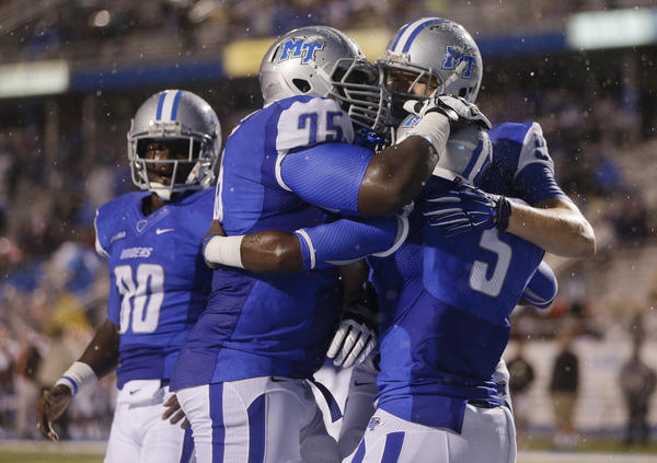 MTSU OL Darius Johnson (75) and RB Jeremiah Bryson (5) celebrate a TD (Photo Courtesy of Mark Humphrey/AP)