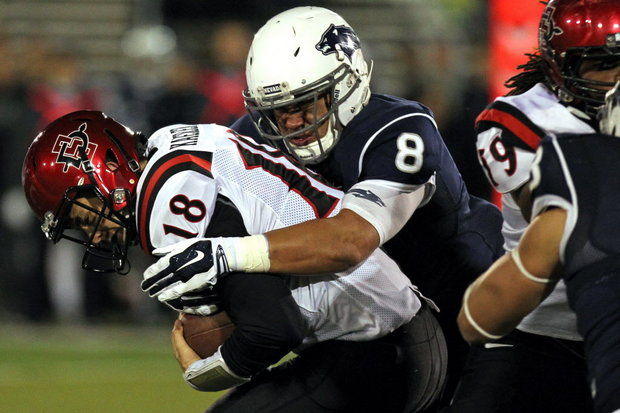 Nevada DL Ian Seau sacks SDSU QB Quinn Kaehler (Photo Courtesy of Lance Iversen/AP Photo)