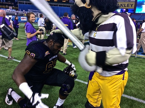 ECU OL Ike Harris being knighted by the ECU mascot (Photo Courtesy of Justin Burnette)