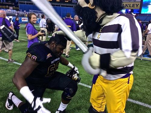 ECU OL Ike Harris being knighted by the ECU mascot (Photo Courtesy of Justin Burnette)