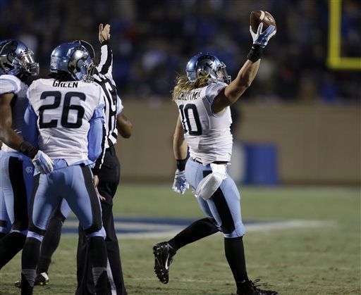 North Carolina's Jeff Schoettmer (10) reacts after recovering a fumble against Duke during the first half of an NCAA college football game in Durham, N.C., Thursday, Nov. 20, 2014. (AP Photo/Gerry Broome)
