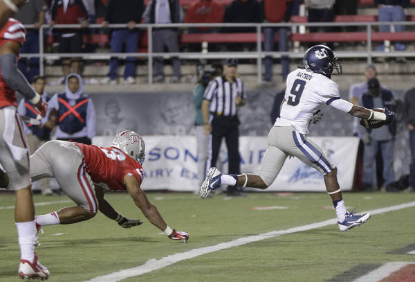 USU WR Jojo Natson crosses the goal line for a touchdown against UNLV (Photo Courtesy of Julie Jacobson/AP Photo)