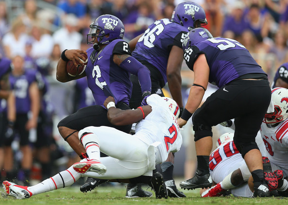 SMU DL Jonathan Yenga brings down TCU QB Trevone Boykin (Photo Courtesy of Ronald Martinez/Getty Images North America)