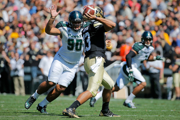 UH DL Kennedy Tulimasealii pressures the Colorado QB (Photo Courtesy of Doug Pensinger/Getty Images North America)