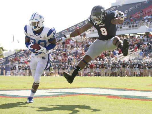 MTSU DB Kevin Byard intercepts a pass against FAU (Photo Coutesy of Associated Press)
