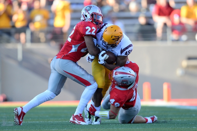 Sep 6, 2014; Albuquerque, NM, USA; New Mexico Lobos defensive back Markel Byrd (22) and New Mexico Lobos linebacker Dakota Cox (49) tackle Arizona State Sun Devils wide receiver Cameron Smith (6) at University Stadium. Arizona State won 58-23 Mandatory Credit: Joe Camporeale-USA TODAY Sports