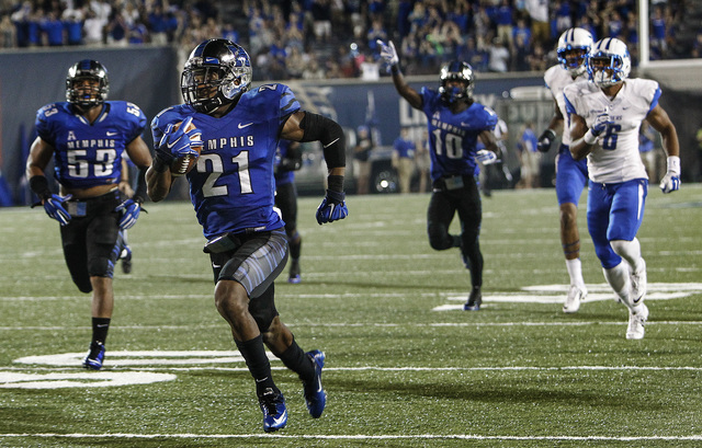 MemphisÕ Bobby McCain (middle) scrambles for a defensive touchdown after grabbing a Middle Tennessee State fumble during second half action of a college football game in Memphis, Tenn. Saturday, September 20, 2014. (AP Photo/The Commercial Appeal, Mark Weber)