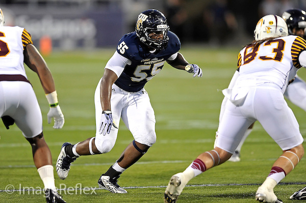 14 September 2013:  FIU defensive end Michael Wakefield (55) pursues the ball carrier in the second half as the Bethune-Cookman Wildcats defeated the FIU Golden Panthers, 34-13, at FIU Stadium in Miami, Florida.