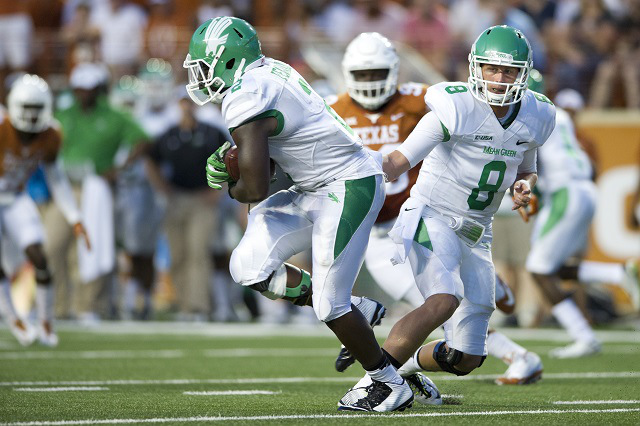 AUSTIN, TX - AUGUST 30:  Josh Greer #8 of the North Texas Mean Green hands the ball off to Reggie Pegram #2 against the Texas Longhorns during the first quarter on August 30, 2014 at Darrell K Royal-Texas Memorial Stadium in Austin, Texas.  (Photo by Cooper Neill/Getty Images)