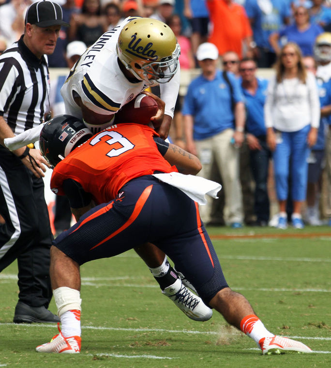 UVA S Quin Blanding tackles UCLA QB Brett Hundley (Photo Courtesy of Ryan M. Kelly/The Daily Progress)