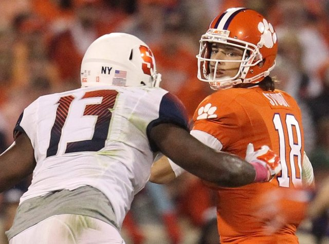 SU DE Ron Thompson pressures Clemson QB Cole Stoudt (Photo Courtesy of Nathan Gray)