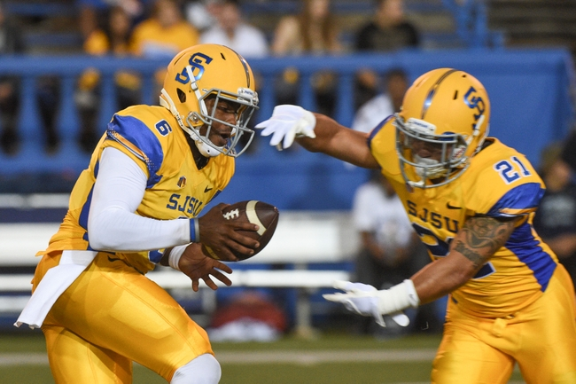 September 27, 2014; San Jose, CA, USA; San Jose State Spartans quarterback Joe Gray (6) hands off to running back Jarrod Lawson (21) before the game against the Nevada Wolf Pack at Spartan Stadium. Mandatory Credit: Kyle Terada-USA TODAY Sports