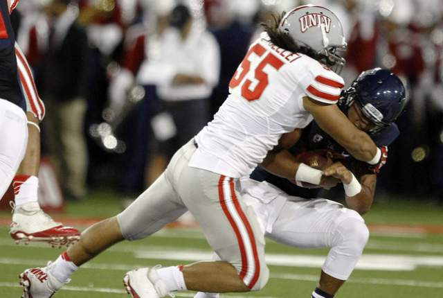 UNLV LB Tau Lotulelei sacks Arizona QB Anu Solomon (Photo Courtesy of AP Photo/Rick Scuteri)
