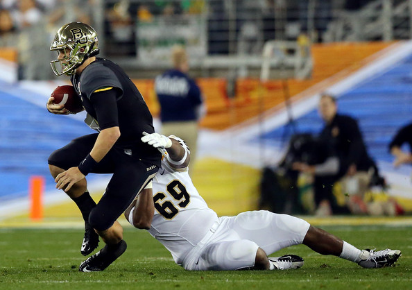 UCF DE Thomas Niles sacks Baylor QB Bryce Petty (Photo Courtesy of Ronald Martinez/Getty Images North America)
