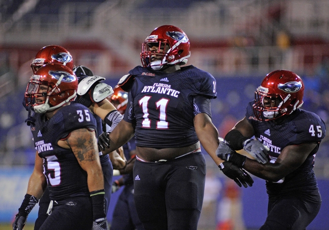 Sep 13, 2014; Boca Raton, FL, USA; Florida Atlantic Owls defensive lineman Trevon Coley (11) celebrates an interception as the Owls beat the Tulsa Golden Hurricane 50-21 at FAU Football Stadium. Mandatory Credit: David Manning-USA TODAY Sports