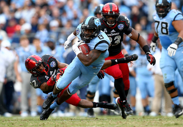 Cincy DB Zach Edwards attempts to bring down a UNC ballcarrier (Photo Couresy of Streeter Lecka/Getty Images North America)