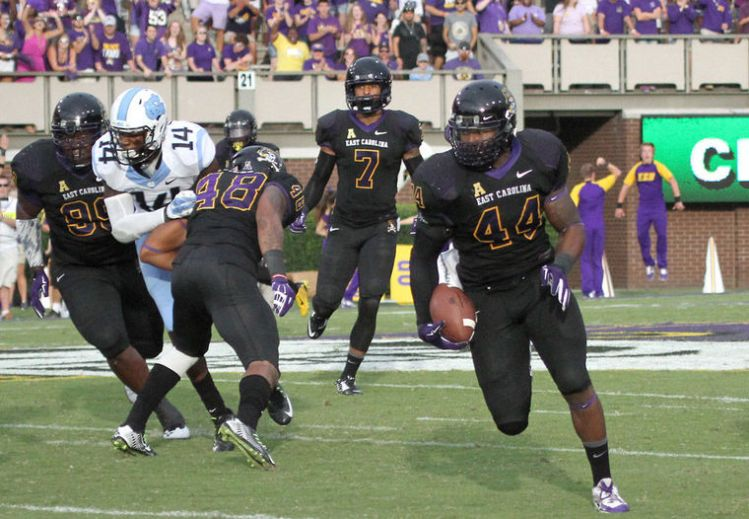ECU LB Zeek Bigger returns an interception for a touchdown (Photo Courtesy of Mike Seegars)