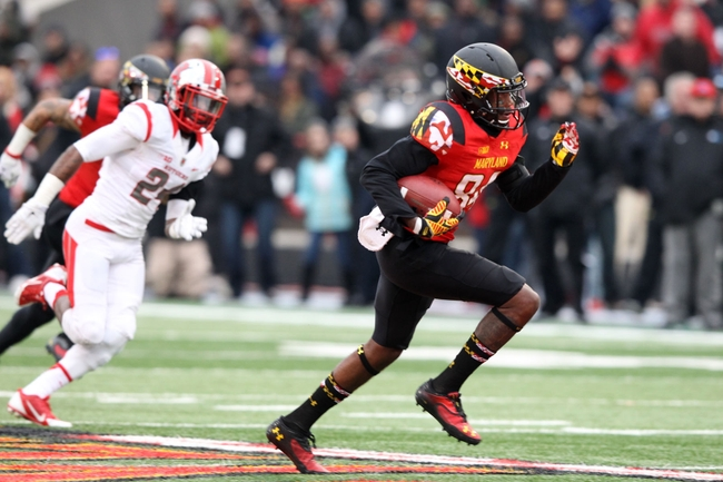 Nov 29, 2014; College Park, MD, USA; Maryland Terrapins wide receiver Amba Etta-Tawo (84) runs for a first half touchdown after his catch against the Rutgers Scarlet Knights at Byrd Stadium. Mandatory Credit: Mitch Stringer-USA TODAY Sports