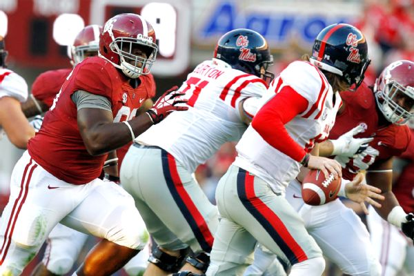 UA DL A'Shawn Robinson pressures Ole Miss QB Bo Wallace (Photo Courtesy of AP Photo/Butch Dill)