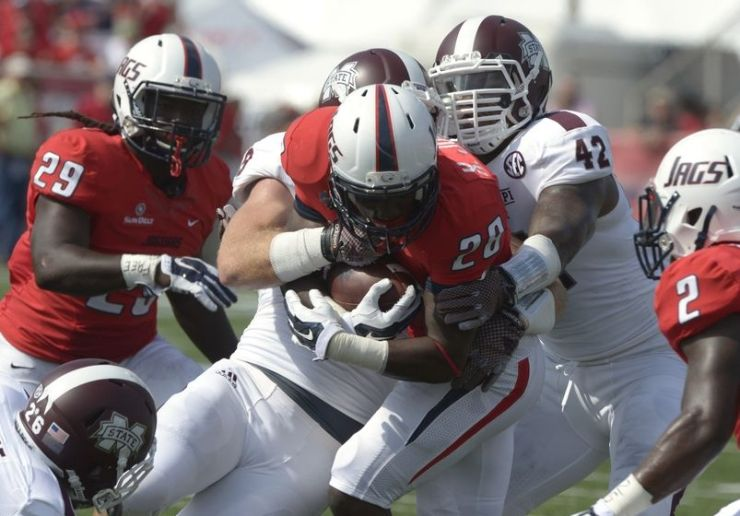 MSU LBs Beniquez and Richie Brown stop a USA ballcarrier (Photo Courtesy of Glenn Andrews/USA TODAY Sports)