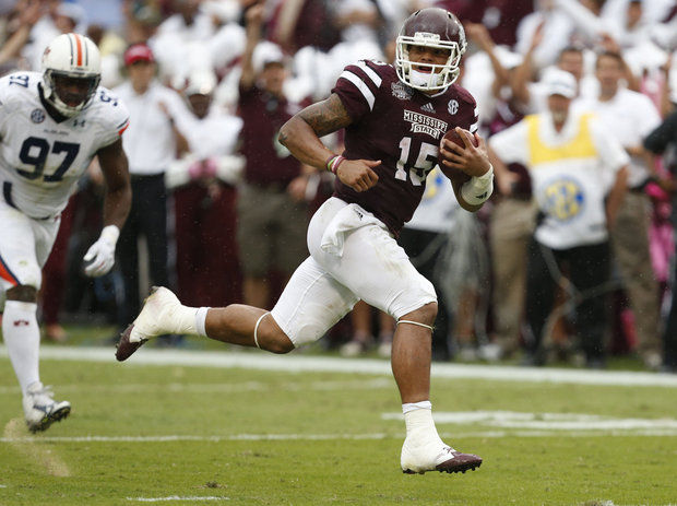 MSU QB Dak Prescott (Photo Courtesy of AP Photo/Rogelio V. Solis)