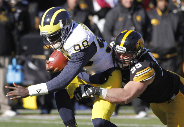 Iowa DE Drew Ott brings down Michigan QB Devin Gardner (Photo Courtesy of Matthew Hoist/Getty Images North America)