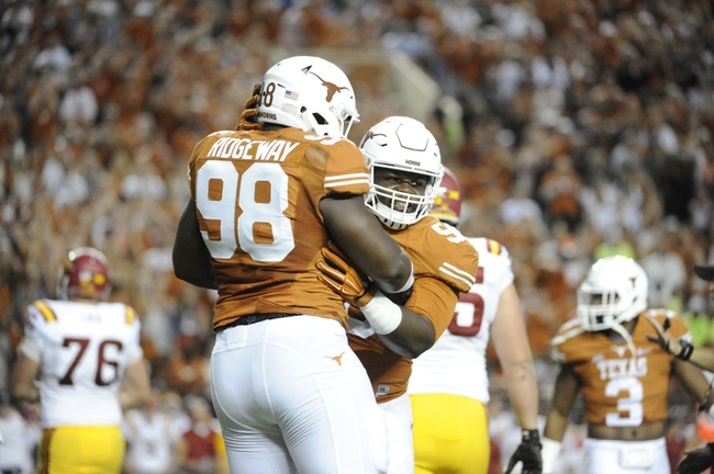 Oct 18, 2014; Austin, TX, USA; Texas Longhorns defensive tackles Hassan Ridgeway (98) and Malcolm Brown (90) react against the Iowa State Cyclones during the first half at Darrell K Royal-Texas Memorial Stadium. Texas beat Iowa State 48-45. Mandatory Credit: Brendan Maloney-USA TODAY Sports
