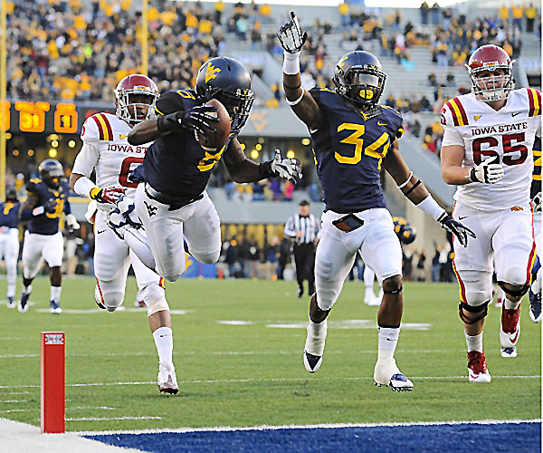 WVU S Karl Joseph dives into the end zone for a TD against ISU (Photo Courtesy of All-Pro Photography/Andrew Ferguson)
