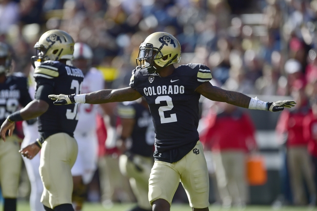 Nov 29, 2014; Boulder, CO, USA; Colorado Buffaloes cornerback Kenneth Crawley (2) reacts to a defensive stop in the first quarter against the Utah Utes at Folsom Field. Mandatory Credit: Ron Chenoy-USA TODAY Sports