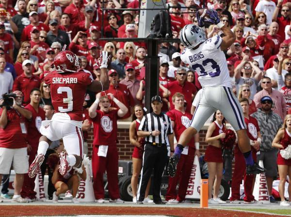 KSU CB Morgan Burns picks off a pass against OU (Photo Courtesy of Sue Ogrocki/AP Photo)