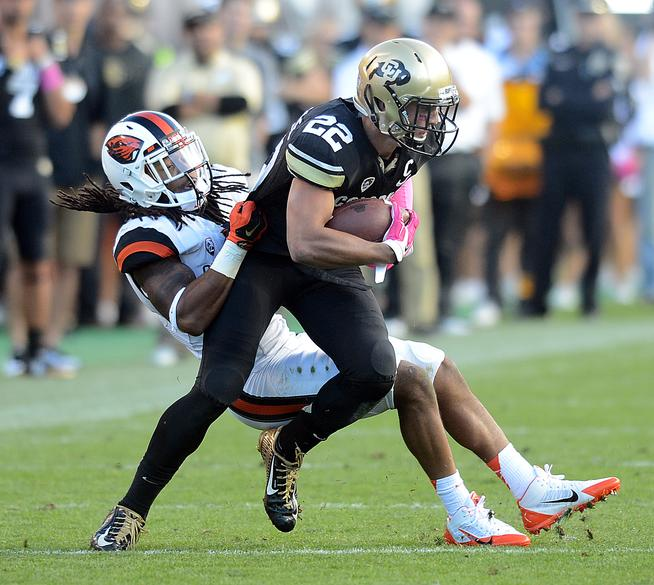CU OSU football664.JPG Nelson Spruce, of CU, is pulled down by Steven Nelson, of OSU, during the second half of the October 4, 2014 game in Boulder. For more photos of CU, go to www.dailycamera.com. Cliff Grassmick / October 4, 2014
