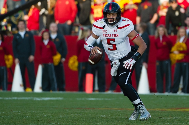 Nov 22, 2014; Ames, IA, USA; Texas Tech Red Raiders quarterback Patrick Mahomes (5) runs with the ball against the Iowa State Cyclones at Jack Trice Stadium. Mandatory Credit: Steven Branscombe-USA TODAY Sports