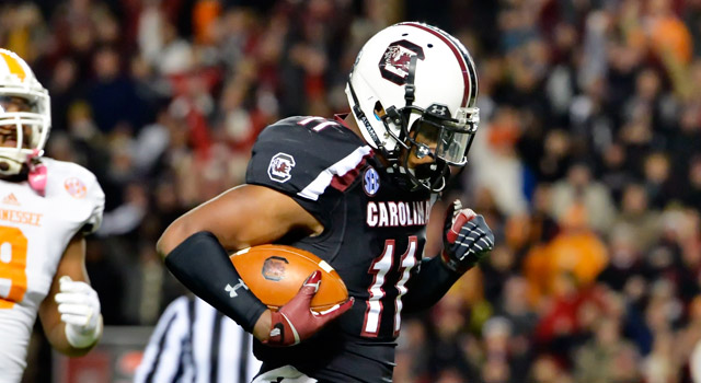 South Carolina's Pharoh Cooper, right, runs in for a touchdown while pursued by Tennessee's Derek Barnett during the first half of an NCAA college football game in Columbia, S.C., Saturday, Nov. 1, 2014. (AP Photo/ Richard Shiro)
