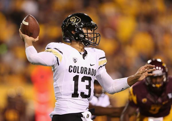 TEMPE, AZ - OCTOBER 12:  Quarterback Sefo Liufau #13 of the Colorado Buffaloes throws a pass during the college football game against the Arizona State Sun Devils at Sun Devil Stadium on October 12, 2013 in Tempe, Arizona.  (Photo by Christian Petersen/Getty Images)