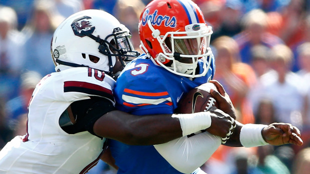 GAINESVILLE, FL - NOVEMBER 15: Treon Harris #3 of the Florida Gators is tackled by Skai Moore #10 of the South Carolina Gamecocks during the game against the South Carolina Gamecocks at Ben Hill Griffin Stadium on November 15, 2014 in Gainesville, Florida. (Photo by Sam Greenwood/Getty Images)