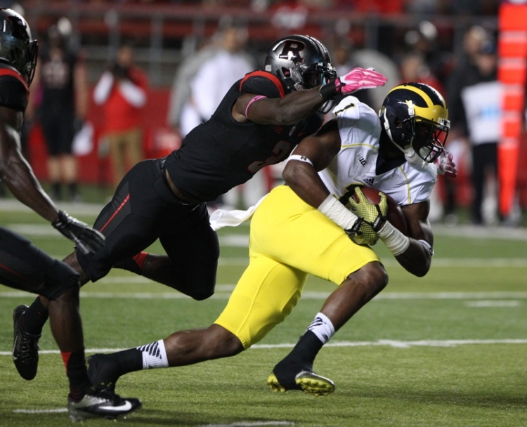 Oct 4, 2014; Piscataway, NJ, USA;   Rutgers Scarlet Knights linebacker Steve Longa (3) tackles Michigan Wolverines wide receiver Devin Funchess (1) during the first half at High Points Solutions Stadium. Mandatory Credit: Noah K. Murray-USA TODAY Sports