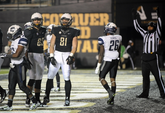 Nov 1, 2014; Nashville, TN, USA; Vanderbilt Commodores tight end Steven Scheu (81) celebrates after a touchdown reception during the first half against the Old Dominion Monarchs at Vanderbilt Stadium. Mandatory Credit: Christopher Hanewinckel-USA TODAY Sports