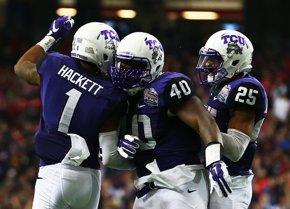 A group of TCU defenders celebrate an INT against Ole Miss (Photo Courtesy of Streeter Lecka/Getty Images North America)