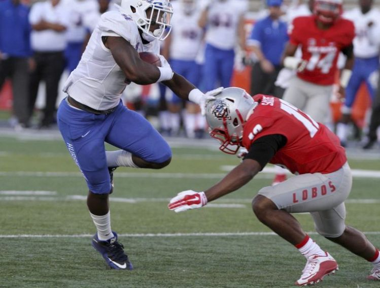 Tulsa RB D'Angelo Brewer breaks a tackle in the 40-21 win over New Mexico (Photo Courtesy of Mark Holm/Associated Press)