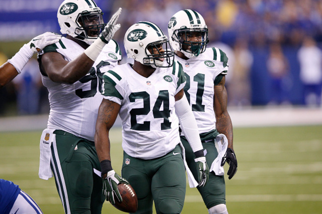 INDIANAPOLIS, IN - SEPTEMBER 21: Darrelle Revis #24 of the New York Jets celebrates after recovering a fumble by Andrew Luck of the Indianapolis Colts in the second quarter at Lucas Oil Stadium on September 21, 2015 in Indianapolis, Indiana. (Photo by Joe Robbins/Getty Images)
