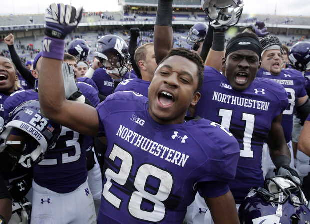 NW RB Justin Jackson and teammates celebrate a win over Stanford (Photo Courtesy of Nam Y. Huh/Associated Press)