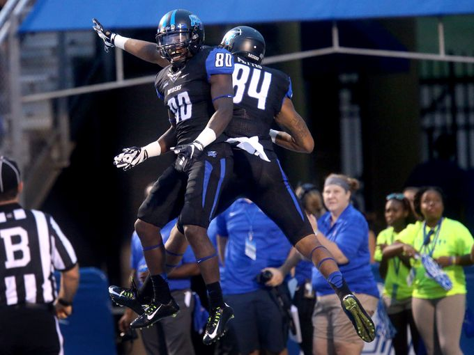 Middle Tennessee players celebrate a score against Charlotte (Photo Courtesy of Helen Comer/Daily News Journal/The Tennessean)